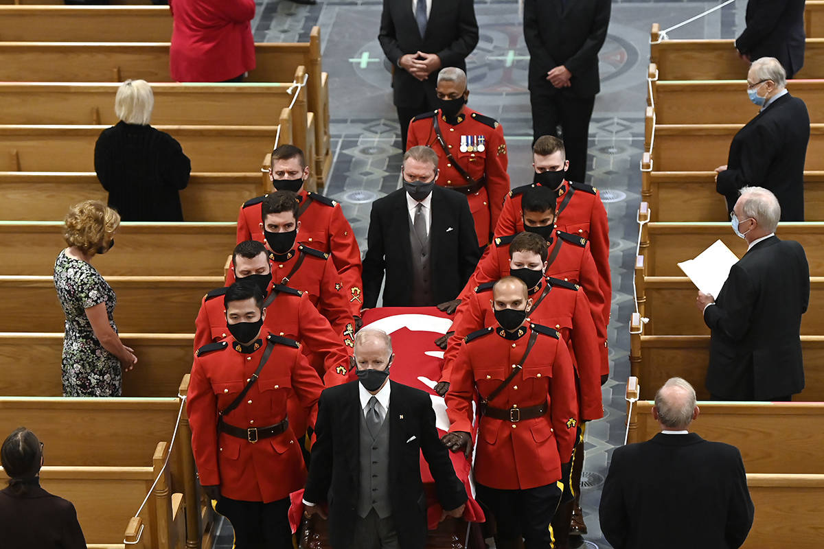 Members of the Royal Canadian Mounted Police carry the casket of former Canadian prime minister John Turner out of St. Michael's Cathedral Basilica during his state funeral service for in Toronto on Tuesday, October 6, 2020. THE CANADIAN PRESS/Nathan Denette