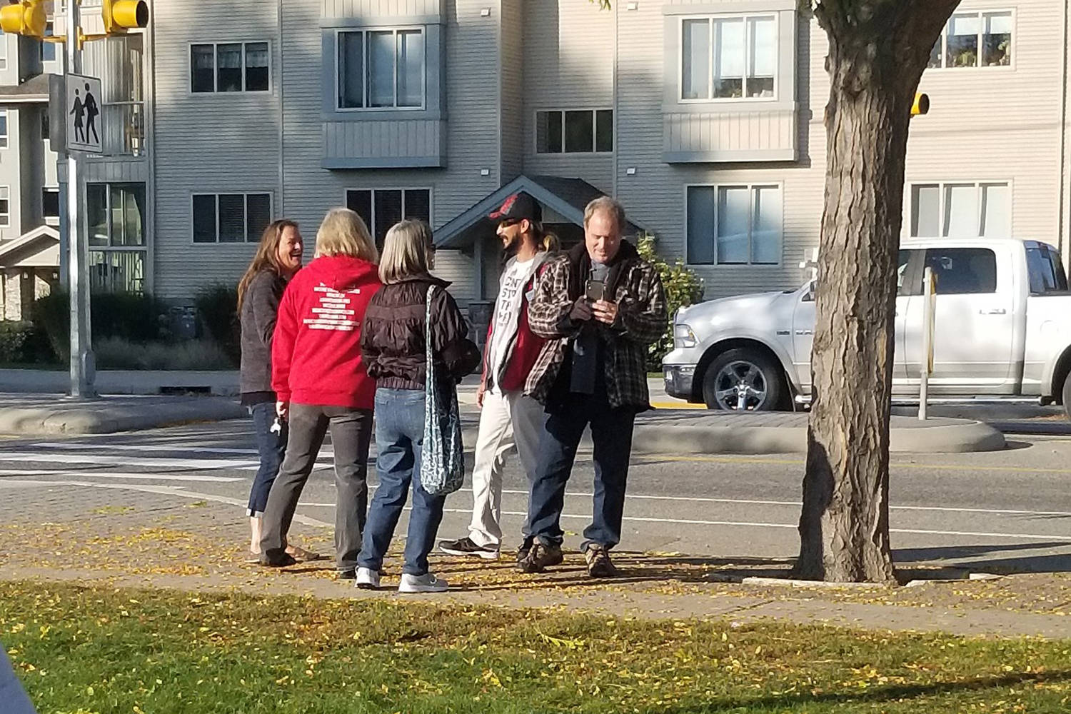 A small group of anti-mask protesters gathered on the sidewalk near Rutland Middle School and Rutland Senior Secondary on Monday, Oct. 5. (Contributed)