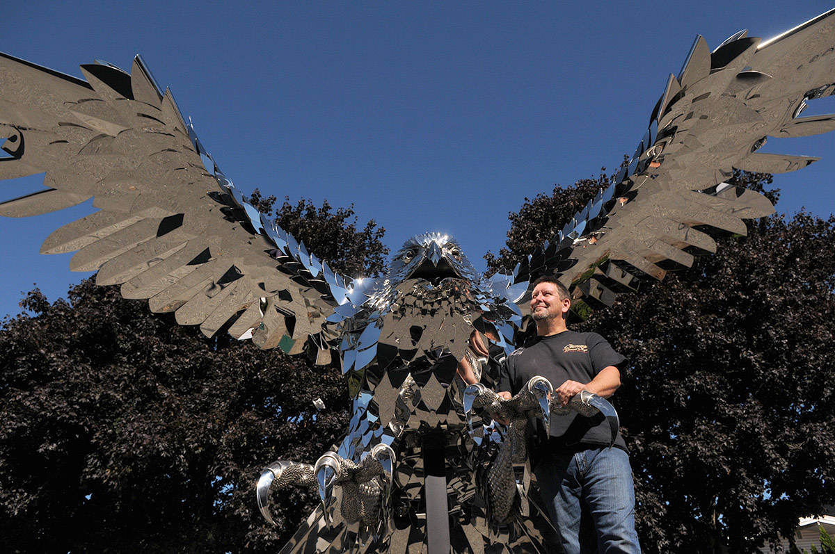 Artist Kevin Stone made this 3,000-pound stainless steel falcon, seen here on display outside his business on Rowat Avenue in Chilliwack on Sept. 29, 2020. (Jenna Hauck/ Chilliwack Progress)