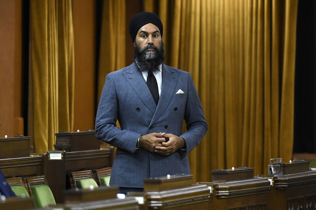 NDP Leader Jagmeet Singh rises as he votes on the Address in Reply to the Speech from the Throne, in the House of Commons on Parliament Hill in Ottawa on Tuesday, Oct. 6, 2020. THE CANADIAN PRESS/Justin Tang