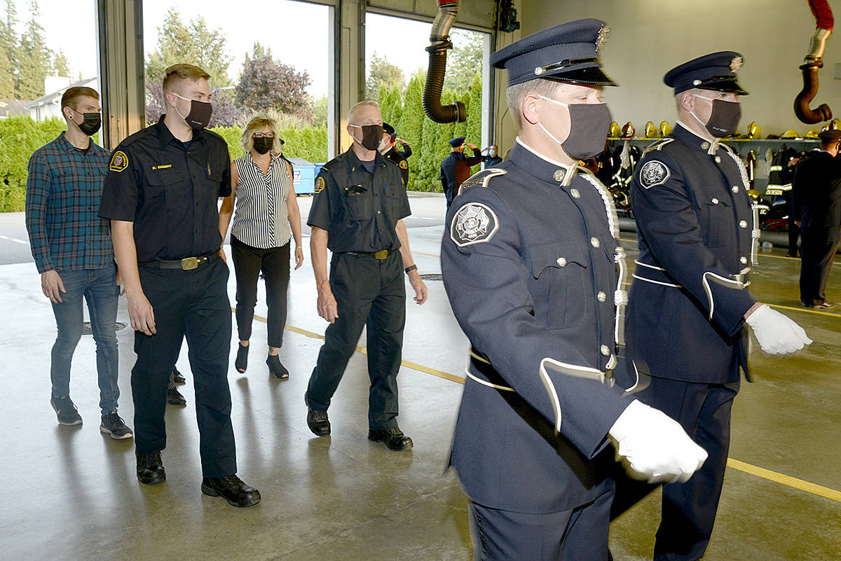 Capt. Morley Sagert, accompanied by his family, was honoured with a 'walk out' ceremony following his retirement shift at firehall #8 - Walnut Grove. (Jhim Burwell/Special to Langley Advance Times)