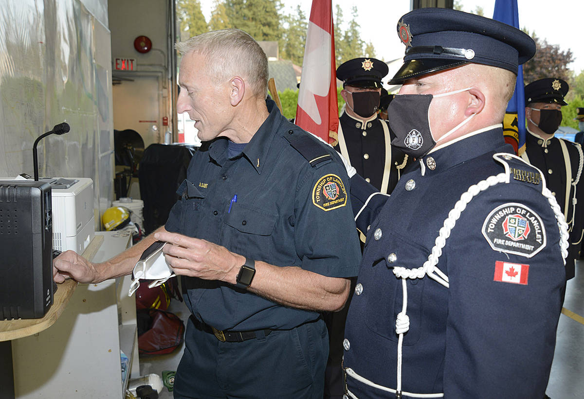 Capt. Morley Sagert answered the ceremonial radio call announcing his retirement on Sept. 30. (Jhim Burwell/Special to Langley Advance Times)