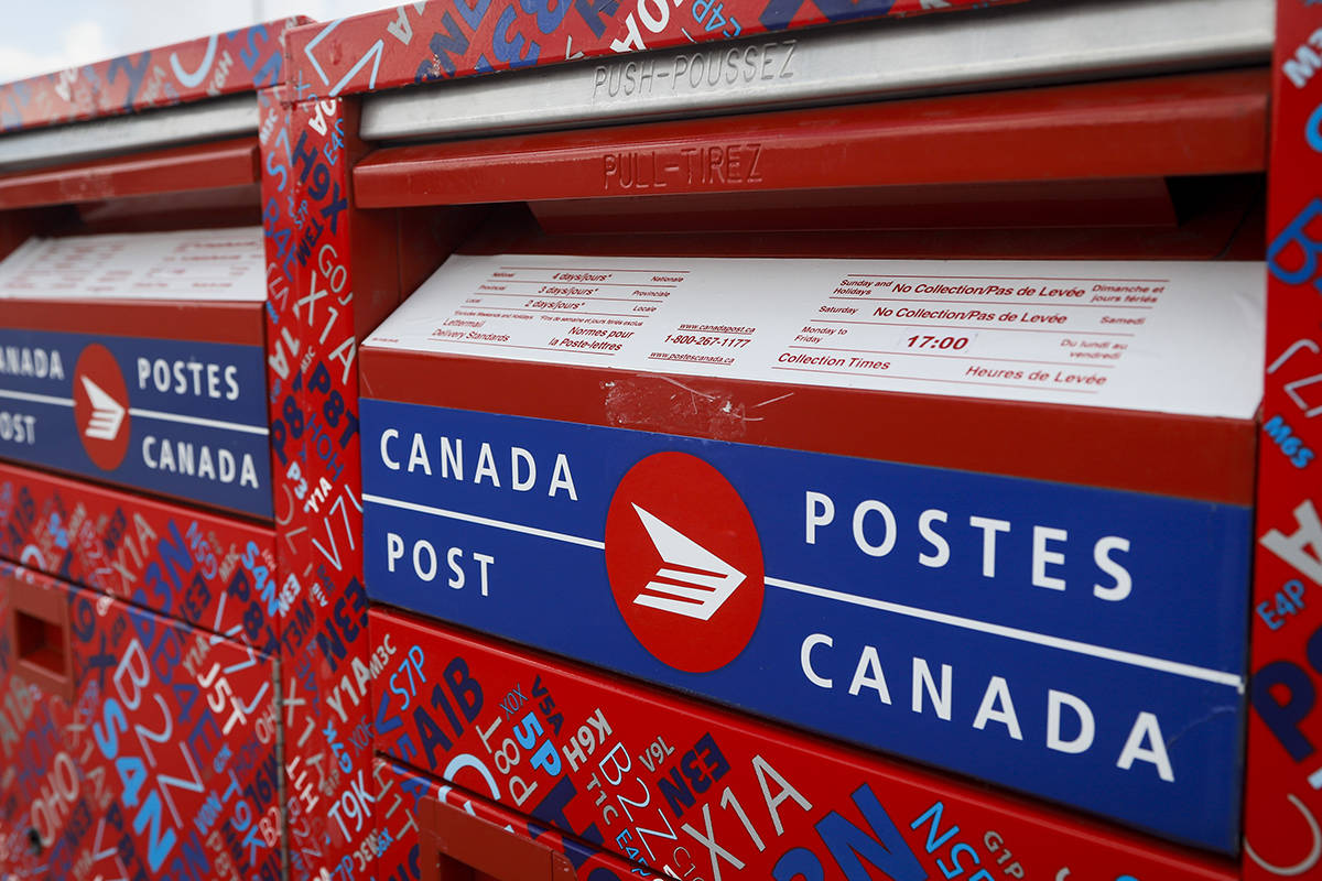 FILE – Mail boxes are seen at Canada Post's main plant in Calgary, Alta., Saturday, May 9, 2020, amid a worldwide COVID-19 pandemic. THE CANADIAN PRESS/Jeff McIntosh