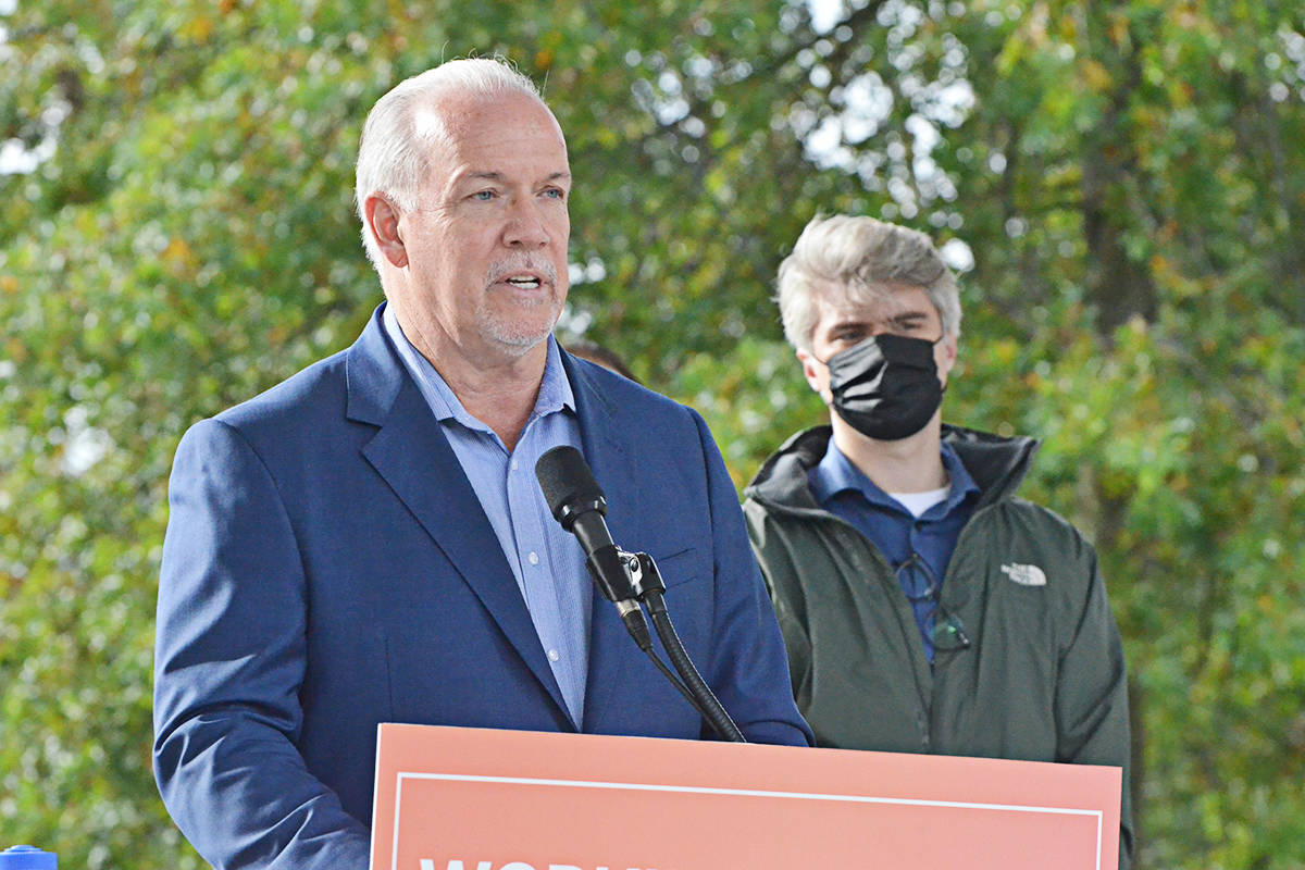 NDP leader John Horgan, with Langley riding candidate Andrew Mercier, announcing a funding pledge to complete the SkyTrain line, in Douglas Park on Thursday, Oct. 8. (Matthew Claxton/Langley Advance Times)