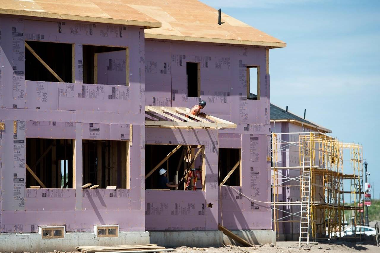 New home construction takes place in a development in Oakville, Ont., on Thursday, Aug. 15, 2019. THE CANADIAN PRESS/Nathan Denette