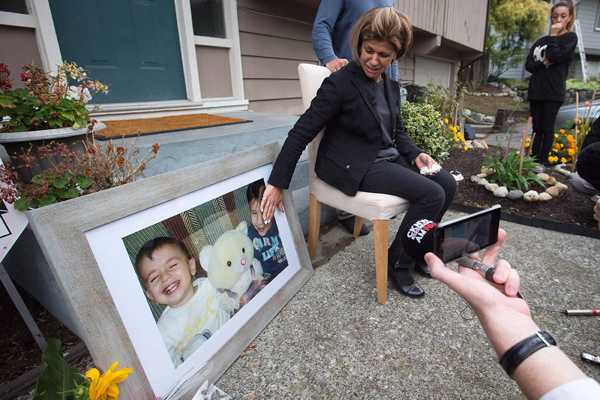 Tima Kurdi, touches a photo of her nephews Alan, left, and Ghalib Kurdi while speaking to the media outside her home in Coquitlam, B.C., on Thursday September 3, 2015. Alan, his older brother Ghalib and their mother Rehan died as they tried to reach Europe from Syria. The uncle of the three-year-old Syrian boy whose lifeless body has put a devastating human face on the Syrian refugee crisis has assailed Canada's refugee process. THE CANADIAN PRESS/Darryl Dyck