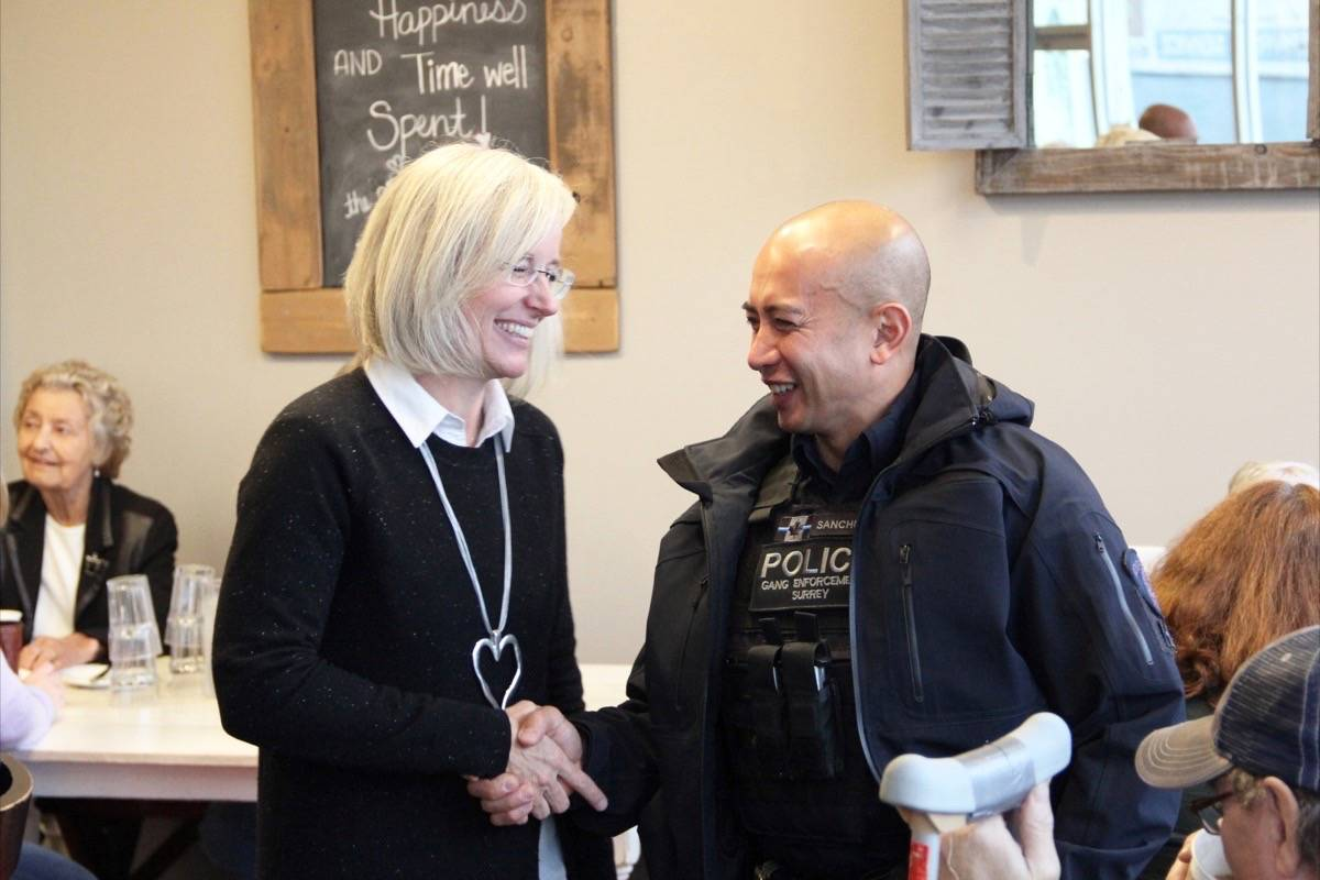 "Tamara Jansen chats with a police officer at an informal ""Coffee with Cops"" chat session in Cloverdale in 2019. Jansen was appointed to the Finance Committee Oct. 6. (Photo: Malin Jordan)"