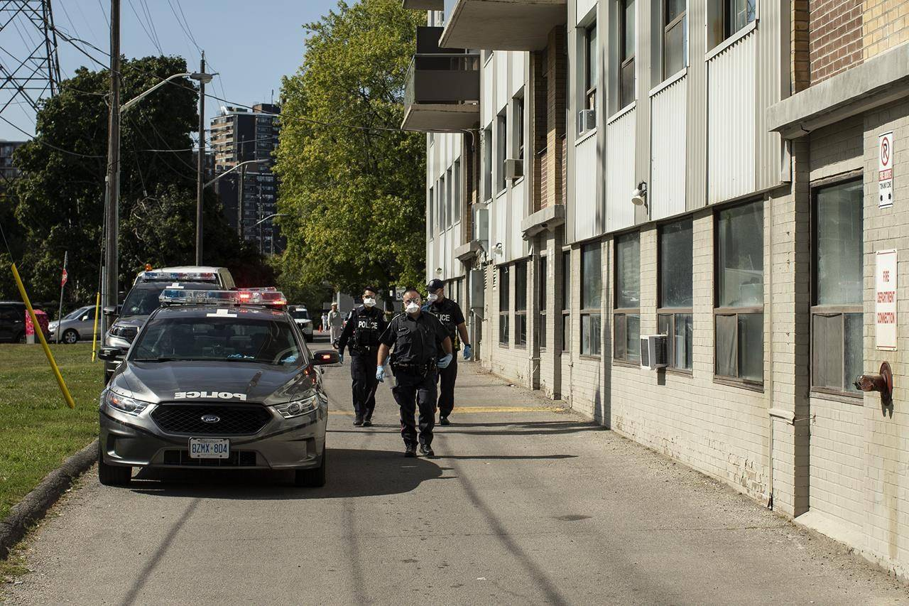Police officers arrive at housing development in Toronto on Monday, September 21, 2020. A new poll suggests Canadians have a largely favourable view of police in their communities but Indigenous people, members of visible minority groups and younger Canadians are less impressed. THE CANADIAN PRESS/Chris Young