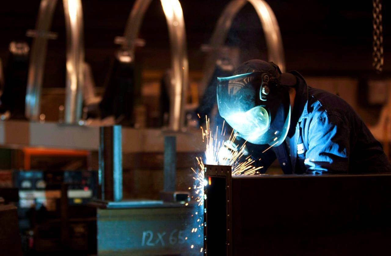 A welder works in a factory in Quebec City, Tuesday, Feb. 28, 2012. THE CANADIAN PRESS/Jacques Boissinot