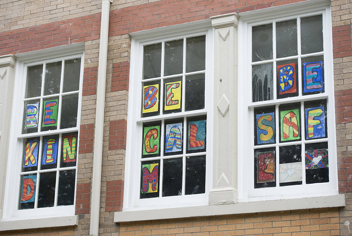 A message is seen in the window during media tour of Hastings Elementary school in Vancouver, Wednesday, September 2, 2020. The Vancouver School Board put on a tour to show the COVID-19 precautions being taken to help keep children safe in the new school year. THE CANADIAN PRESS/Jonathan Hayward
