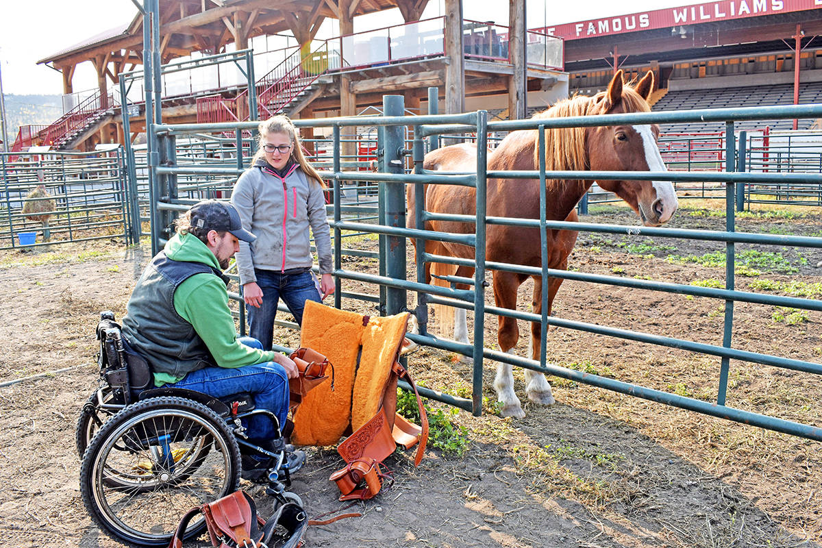 Thompson Rivers University Applied Sustainable Ranching Program students Kevin Cunin (left) and Wendy Meijdam show off a modified saddle recently made for Cunin, who is paralyzed from the chest down, so he can compete in team roping. (Rebecca Dyok photo)