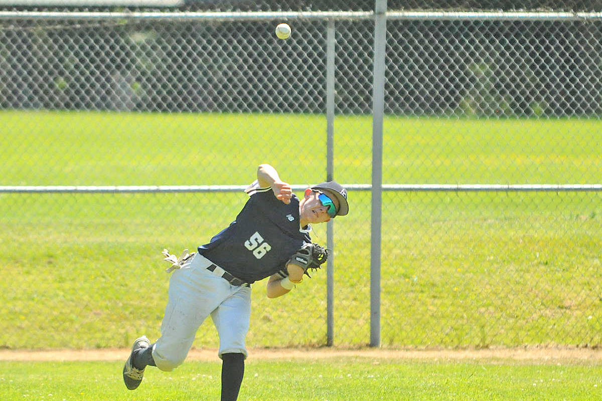 Langley Junior Blaze player Russell Young fires the ball back into the infield during game two of a 2017 doubleheader against the Victoria Junior Mariners at Langley's City Park. (Langley Advance Times file)