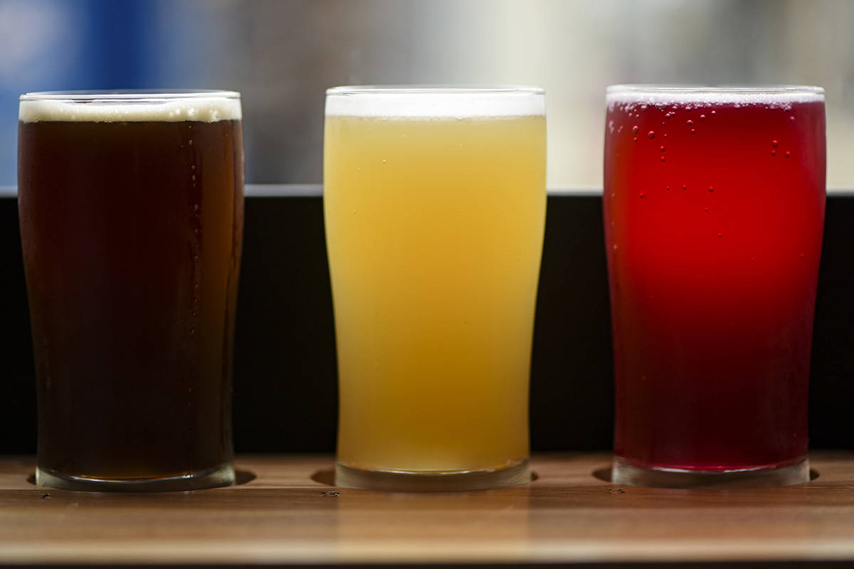 There is no shortage of beer varieties in British Columbia. From left are a Saison Noel from Howl Brewing and a Humans Hazy IPA from Parkside Brewing and a Beets by Sinden Beet Sour from Electric Bicycle Brewing, at Refuge Tap Room on Fort Street. (Don Denton - Boulevard)