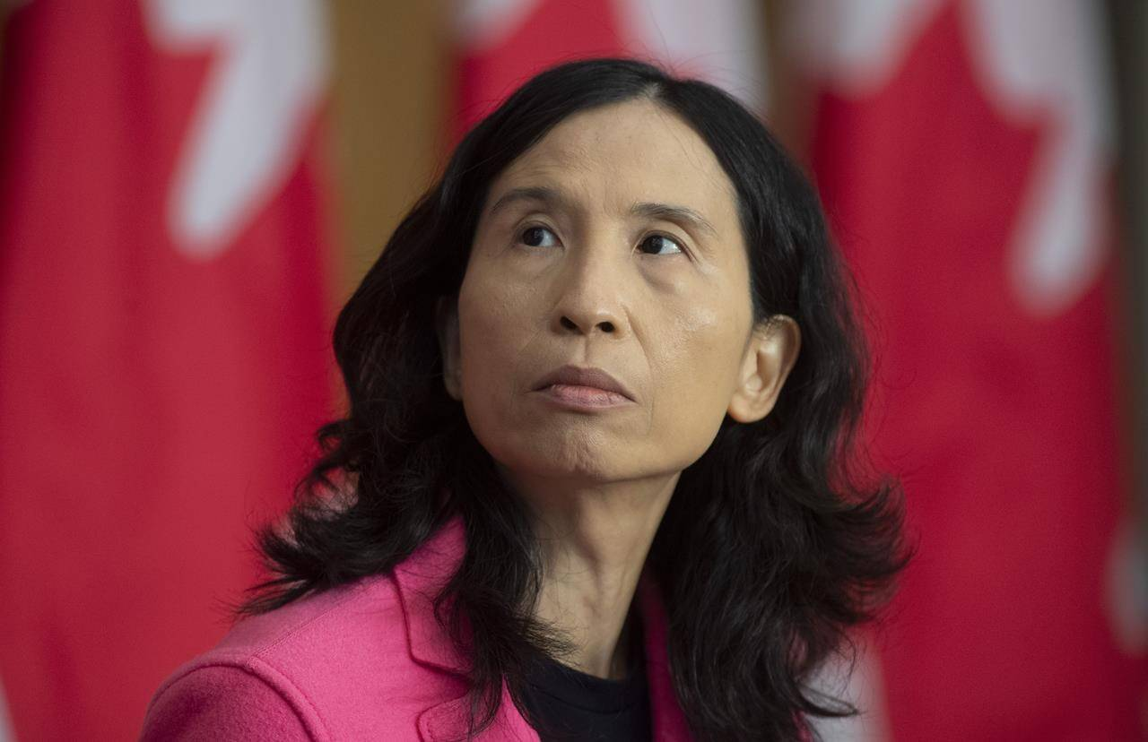 Chief Public Health Officer Theresa Tam looks at a slide projected on a screen during a news conference in Ottawa, Friday, Oct. 9, 2020. THE CANADIAN PRESS/Adrian Wyld