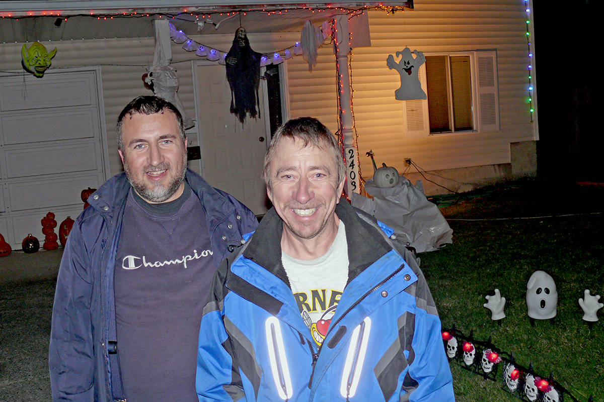 Brothers Tony (left) and Peter Beier have been celebrating Halloween together for the past five years, going a little bigger every time. This year, they set up early on Saturday, Oct. 11, at Peter's home on Wayburne Crescent in Langley for the benefit of essential workers during the pandemic. (Dan Ferguson/Langley Advance Times)