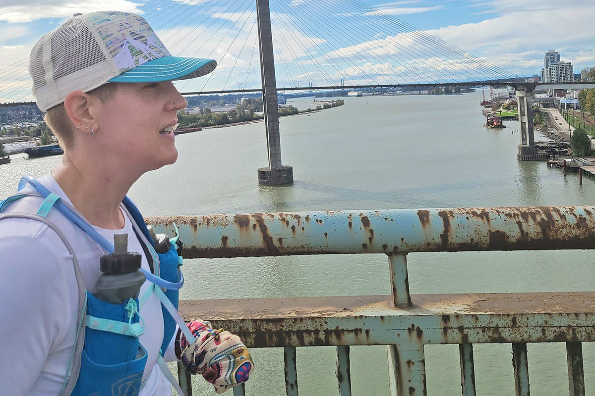 Langley nurse Sheila Henry crosses the bridge to New Westminster on Saturday, Oct. 11, en route to completing a 50K run from Langley City to Vancouver to raise awareness about the drug overdose crisis (Special to Langley Advance Times)