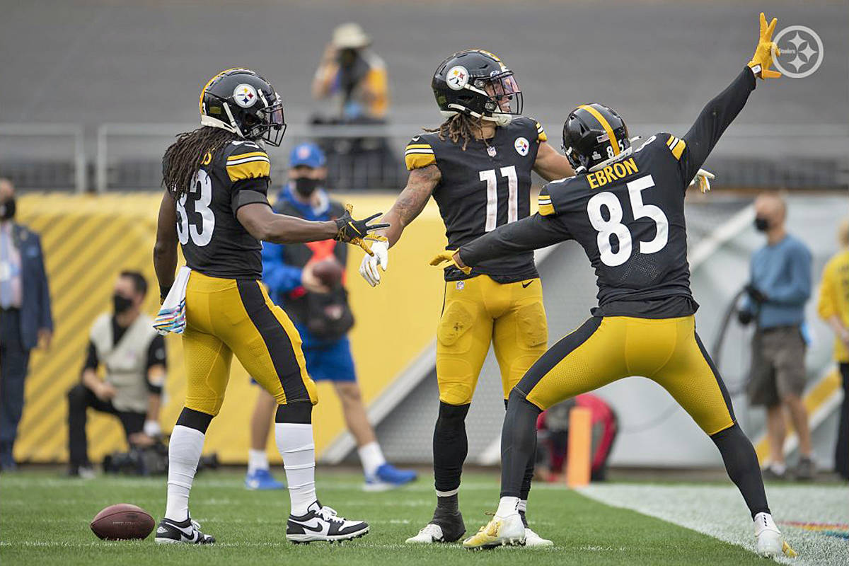 Chase Claypool celebrates one of four touchdowns he scored for the Pittsburgh Steelers en route to a 38-29 win over the Eagles on Sunday, Oct. 11 at Heinz field, becoming the first Steelers rookie to hit the mark (Karl Roser/Pittsburgh Steelers)