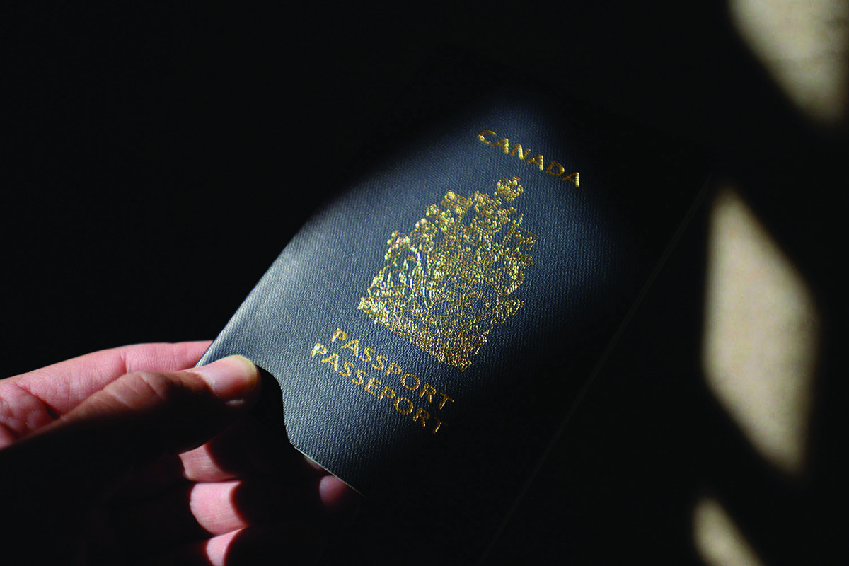 A Canadian passport is displayed in Ottawa on July 23, 2015. THE CANADIAN PRESS/Sean Kilpatrick