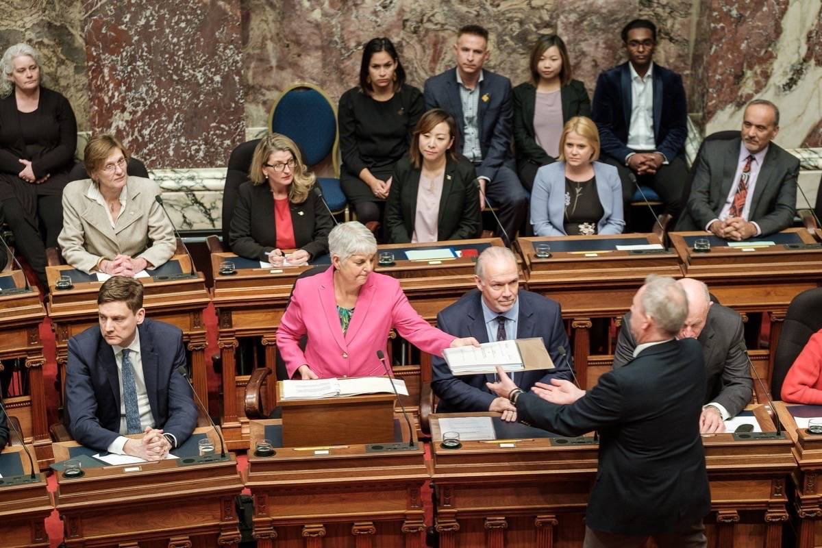 B.C. Finance Minister Carole James presents her last budget in the B.C. legislature, Feb. 18, 2020. Its modest surplus forecast was quickly erased by COVID-19 and a deficit nearing $13 billion. (B.C. government photo)
