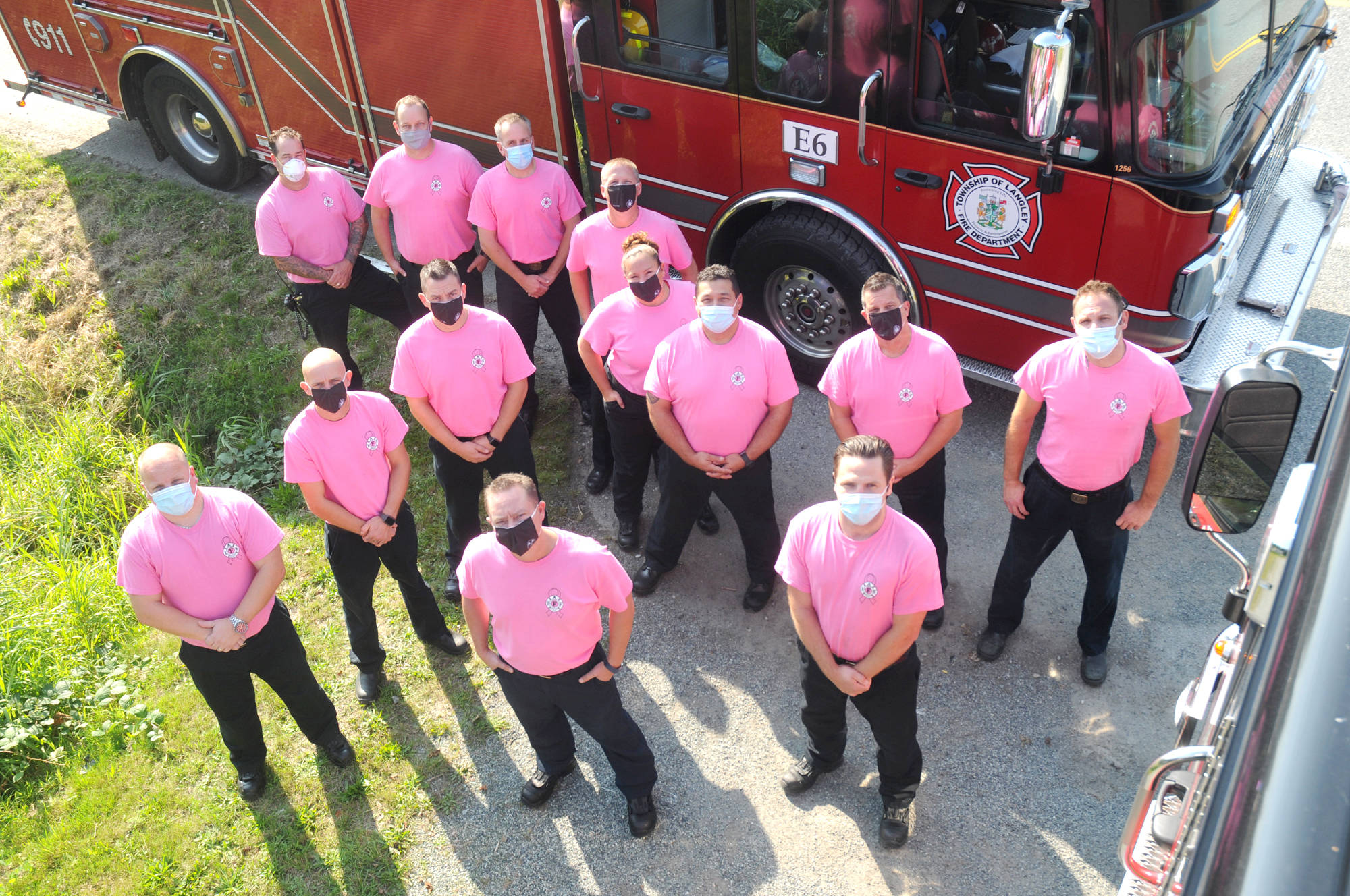 Members of the Township of Langley Fire Department dawn pink for 2020 Breast Cancer Awareness Month. (Jhim Burwell/Special to Langley Advance Times)