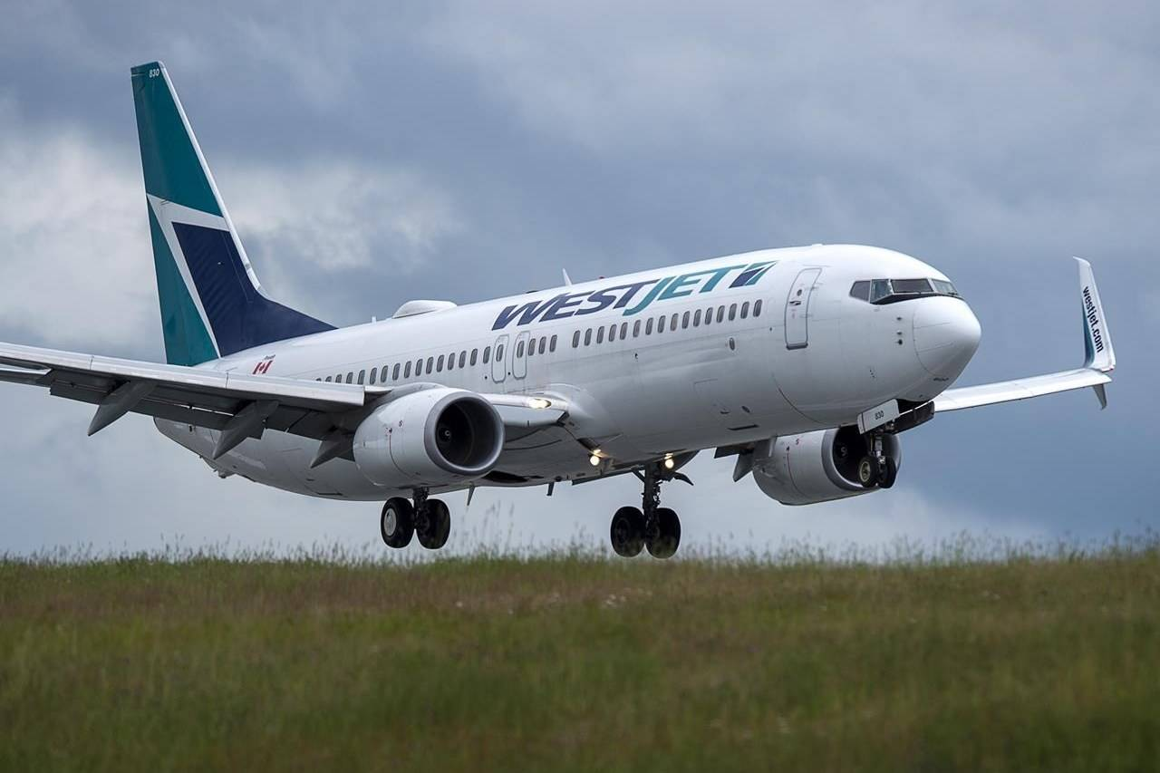 WestJet says it is indefinitely suspending operations to several east coast cities, as well as suspending operations between Toronto and Quebec City. A WestJet flight from Calgary arrives at Halifax Stanfield International Airport in Enfield, N.S. on Monday, July 6, 2020. THE CANADIAN PRESS/Andrew Vaughan