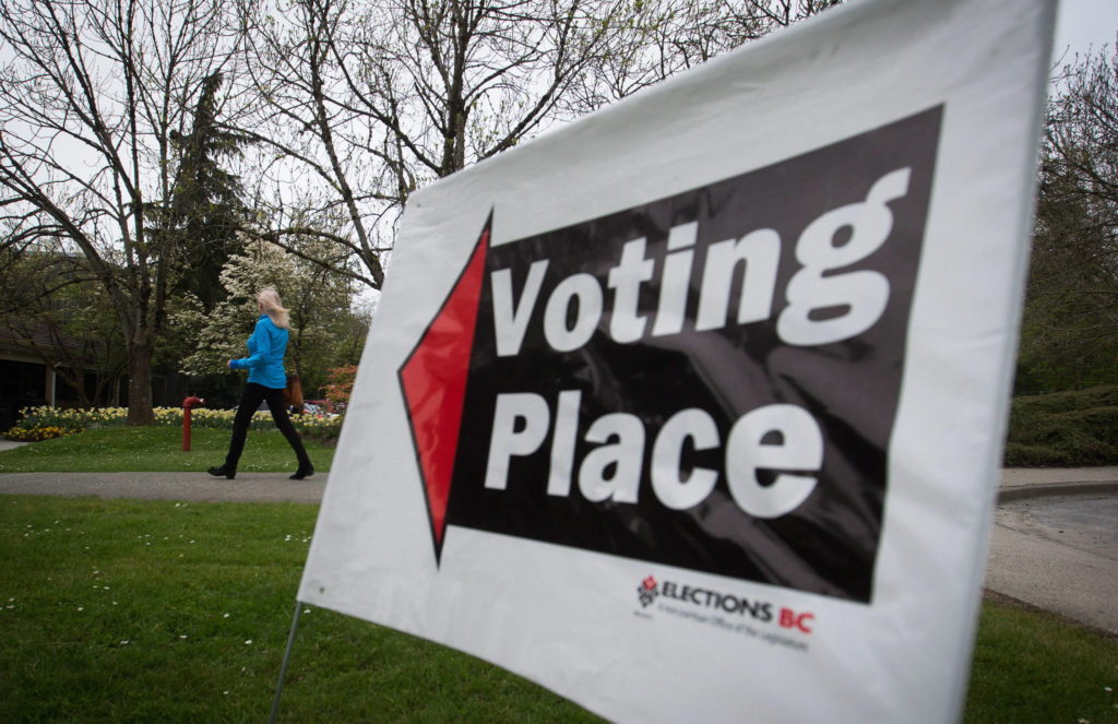A woman arrives at a polling station to vote in the provincial election in the riding of Vancouver-Fraserview, in Vancouver, B.C., on Tuesday May 9, 2017. THE CANADIAN PRESS/Darryl Dyck