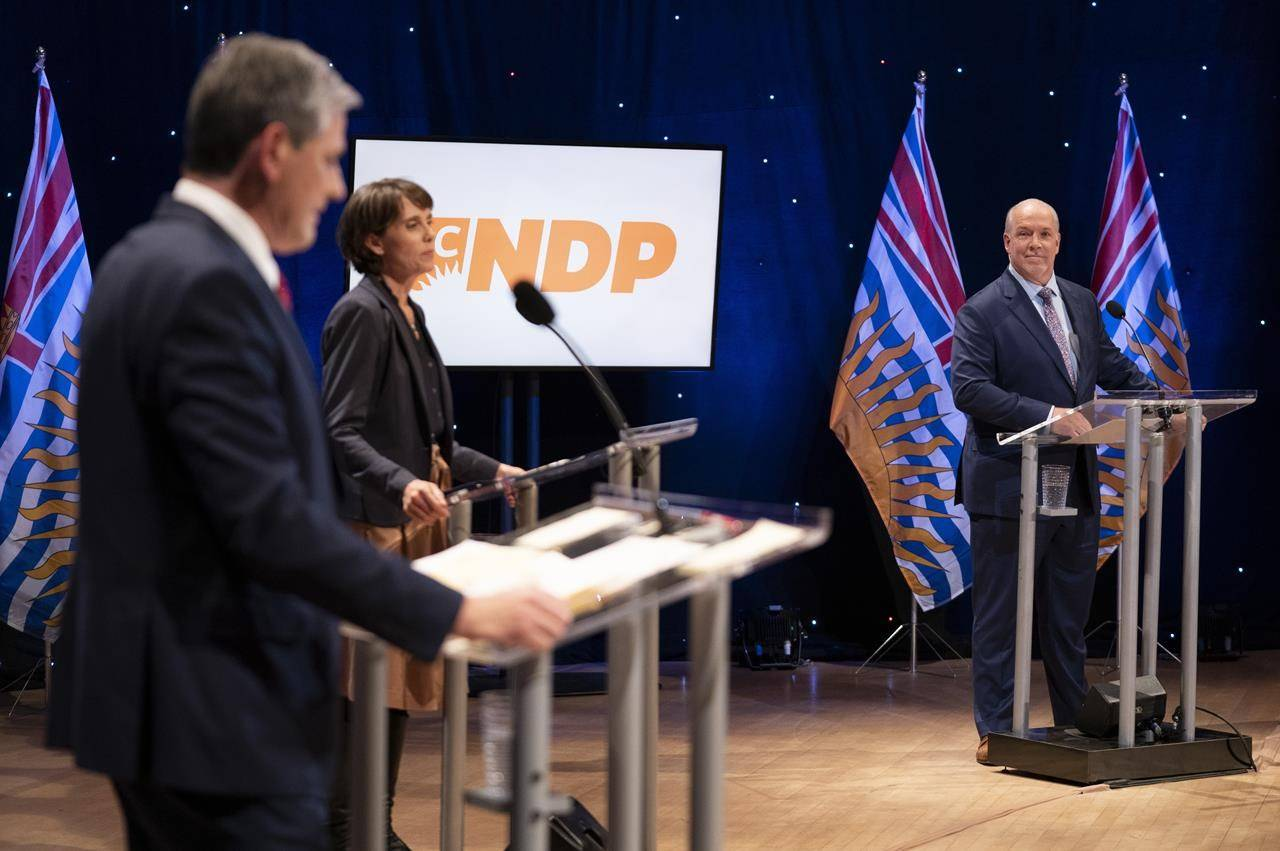 NDP Leader John Horgan, right to left, Green leader Sonia Furstenau and Liberal leader Andrew Wilkinson prepare for a debate at the Chan Centre in Vancouver, B.C., Tuesday, October 13, 2020. THE CANADIAN PRESS/Jonathan Hayward
