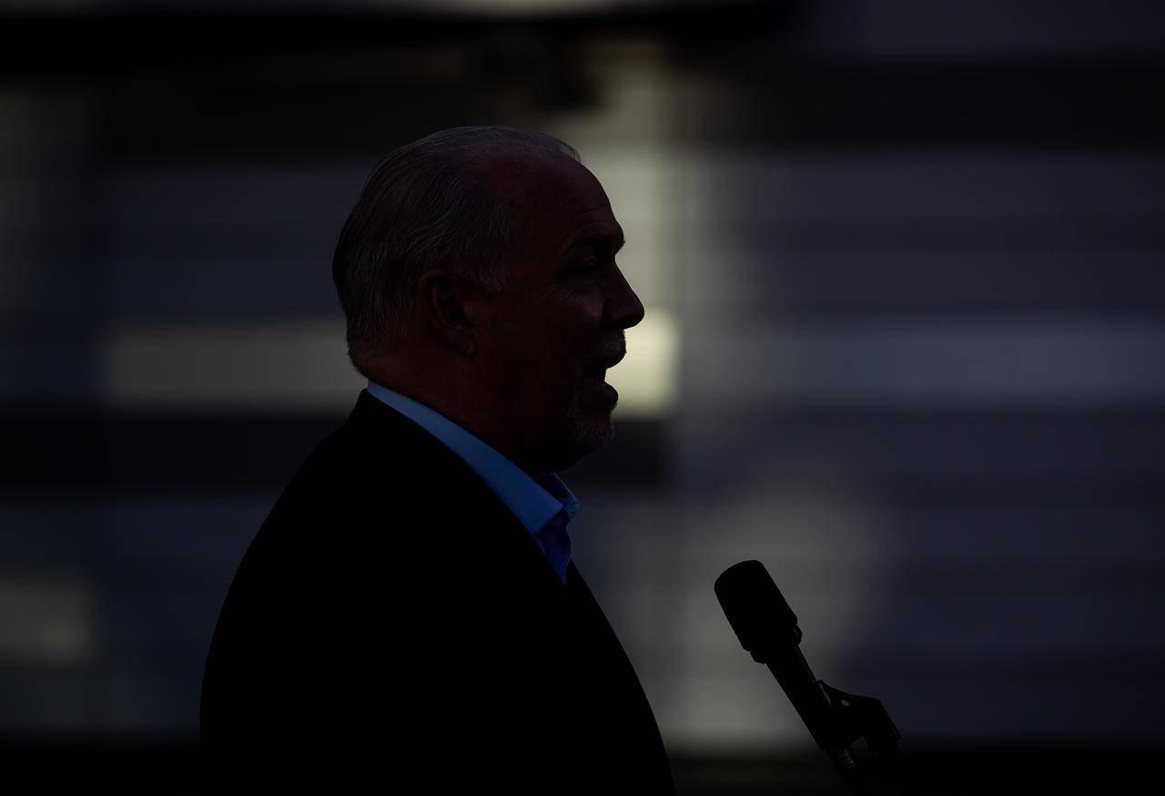 NDP Leader John Horgan is silhouetted while speaking during a campaign stop in Vancouver on Wednesday, October 7, 2020. At the end of a recent virtual town hall meeting where about a dozen people asked questions about British Columbia's Oct. 24 election, Horgan said he was enjoying campaigning online.THE CANADIAN PRESS/Darryl Dyck