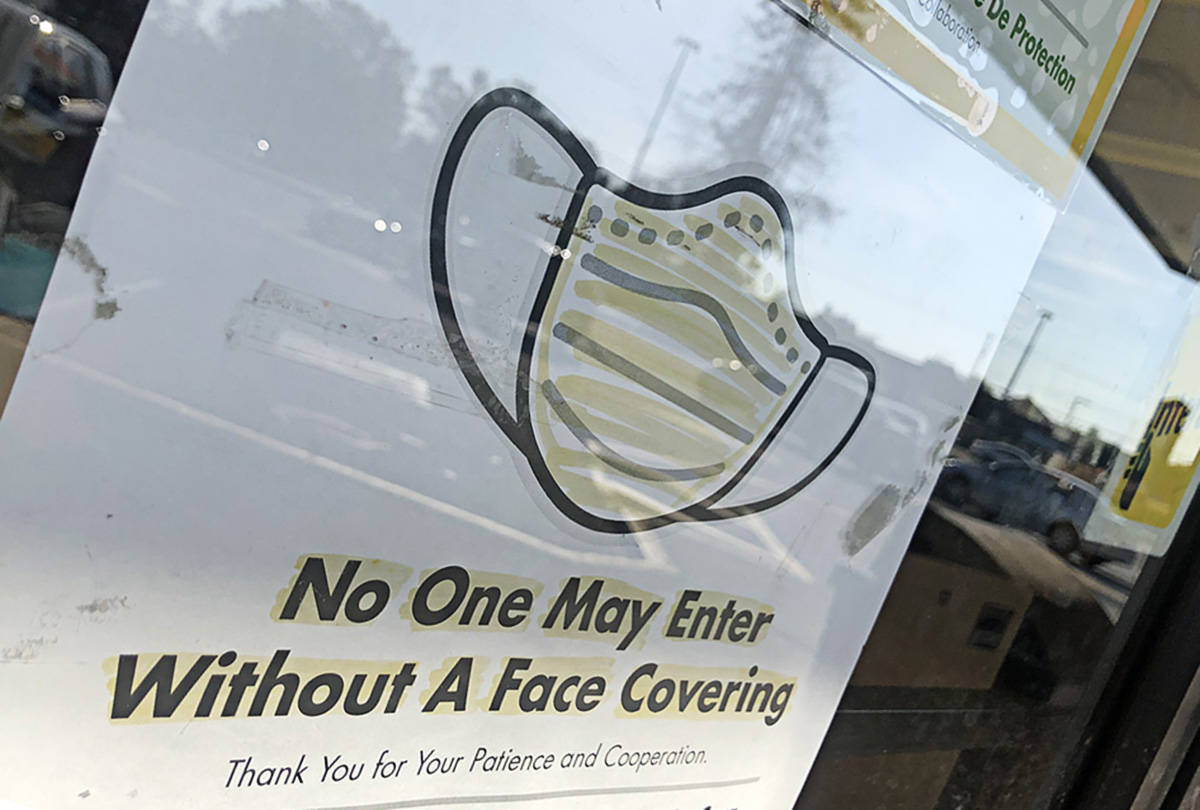 Although B.C. has not made masks mandatory in public indoor spaces, some business owners are requiring all customers to wear them before entering their store. (Ashley Wadhwani/Black Press Media)