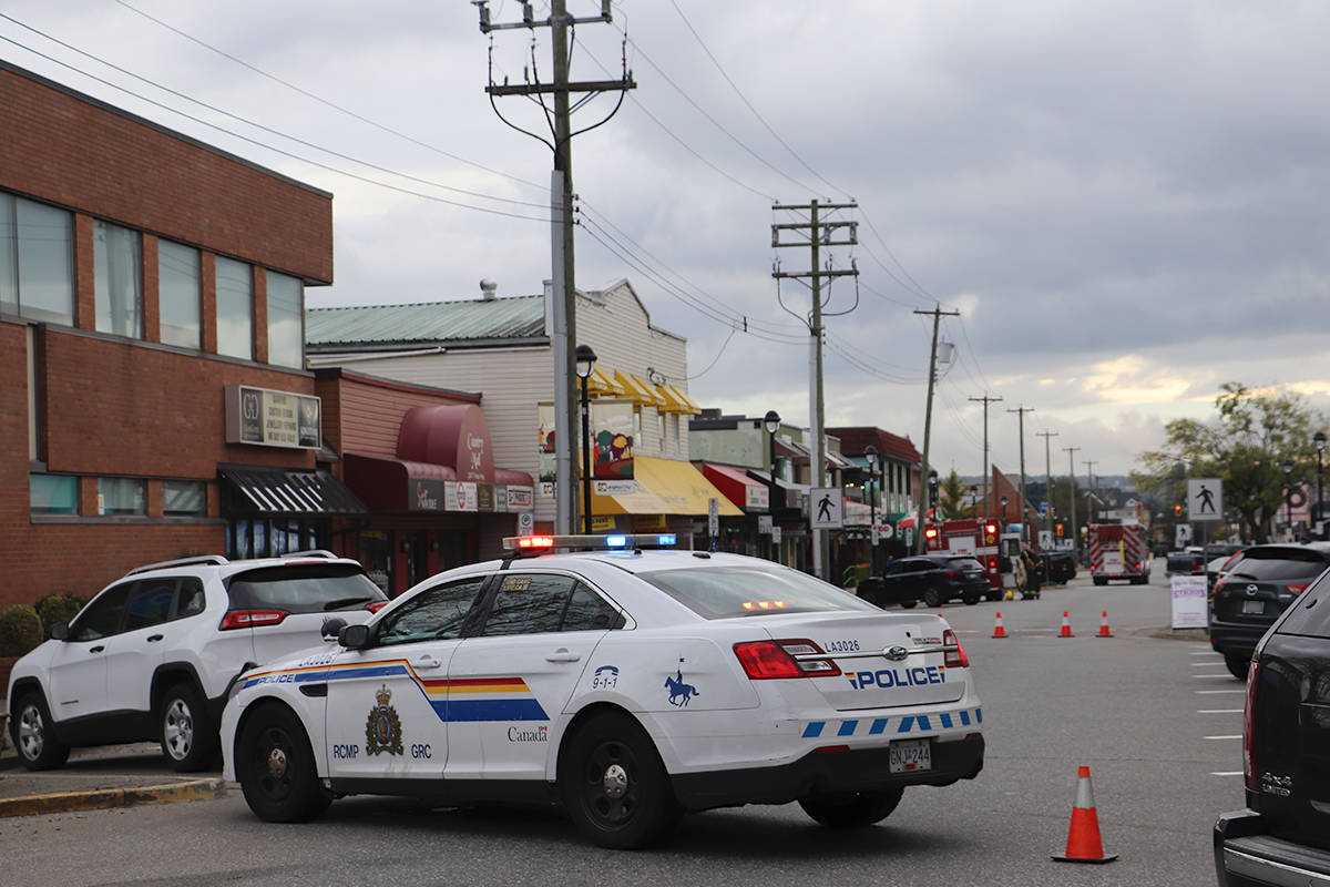 Police had blocked traffic along the one-way on Fraser Highway in downtown Langley City on Thursday, Oct. 15, 2020 after a report of a sudden death. (Joti Grewal/Langley Advance Times)