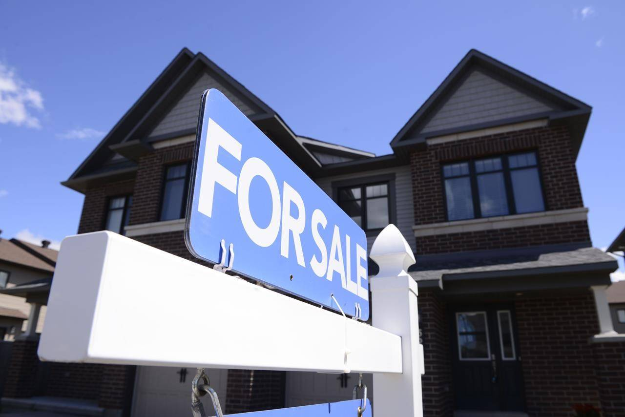 A new home is displayed for sale in a new housing development in Ottawa on Tuesday, July 14, 2020. The Canadian Real Estate Association says home sales in September hit another record for the month as they continued to climb higher and prices soared.THE CANADIAN PRESS/Sean Kilpatrick