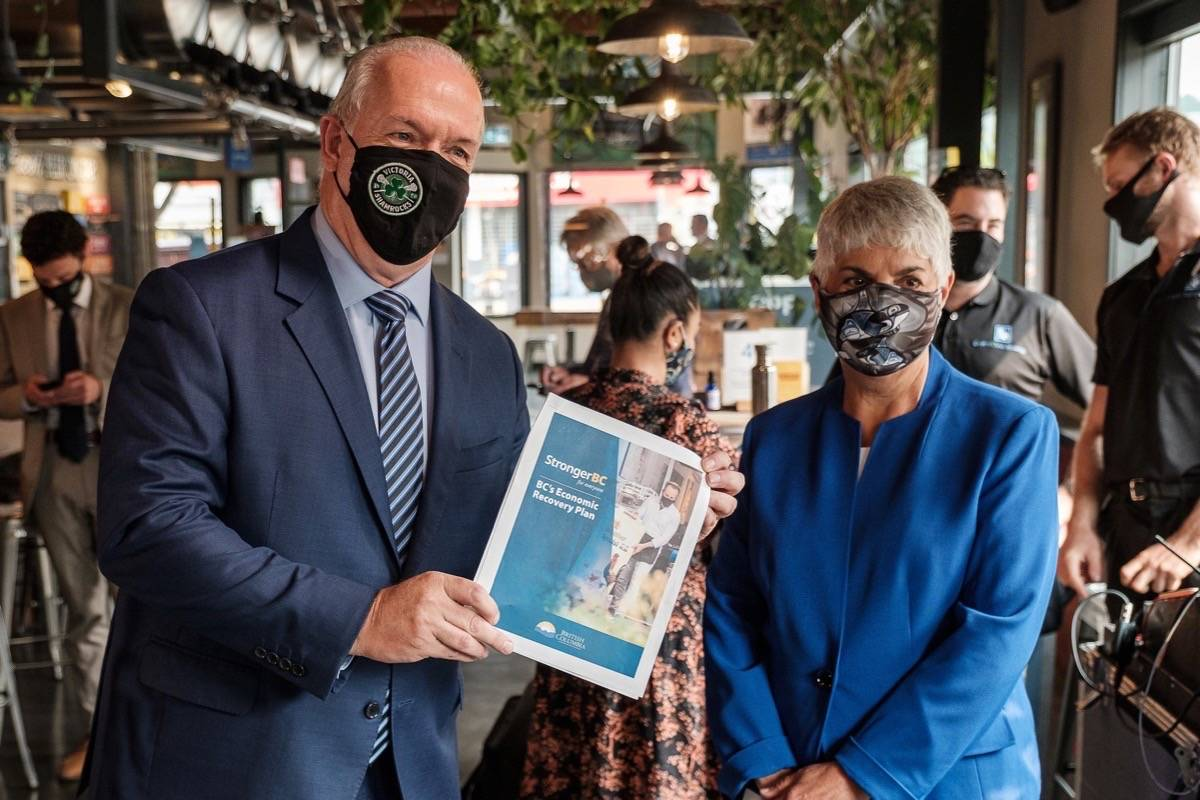"""B.C. NDP leader John Horgan and former finance minister Carole James roll out """"StrongerBC,"""" a $1.5 billion business support plan for COVID-19, seven months after the B.C. legislature approved borrowing the money and four days before a snap election call, Sept. 17, 2020. (B.C. government photo)"""