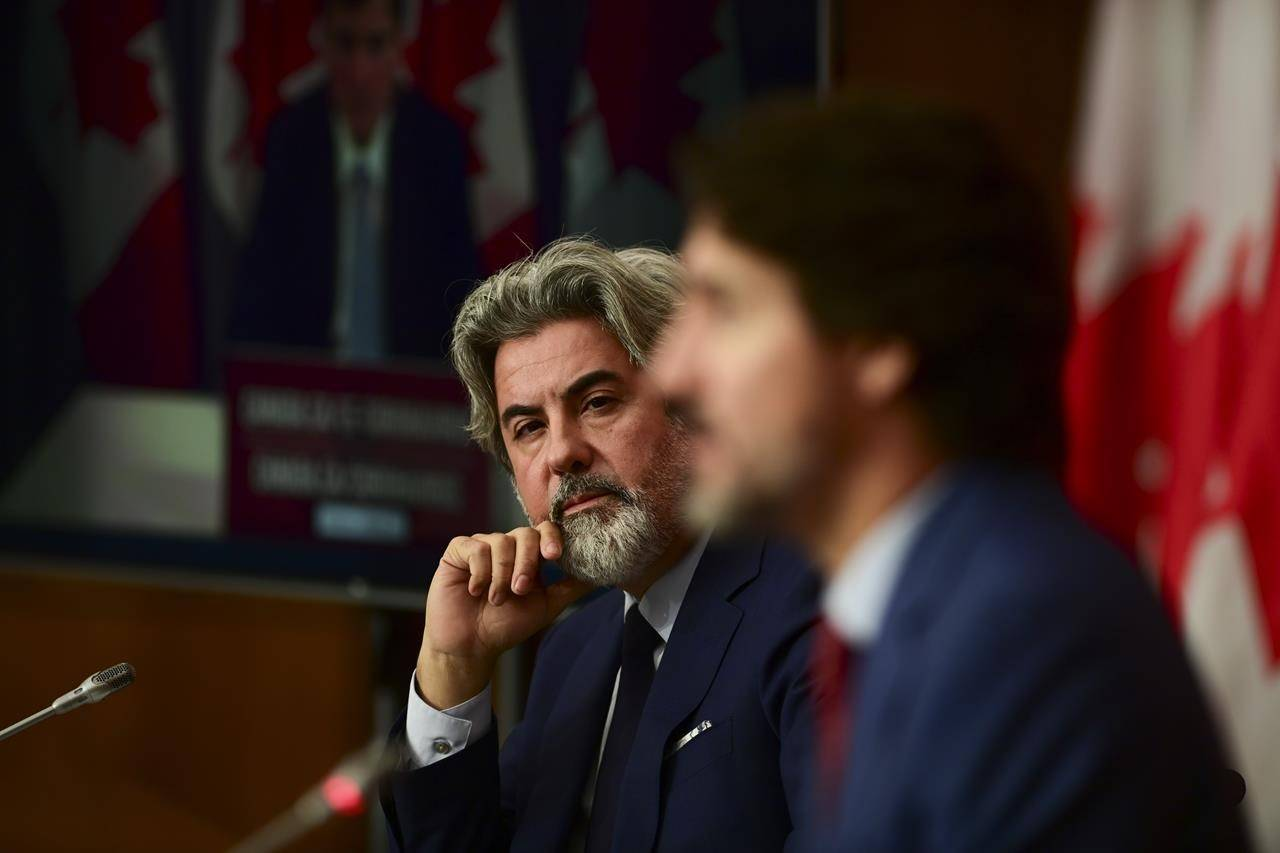 Leader of the Government in the House of Commons Pablo Rodriguez looks towards Prime Minister Justin Trudeau as they take part in a press conference during the COVID pandemic in Ottawa on Friday, Oct. 16, 2020. THE CANADIAN PRESS/Sean Kilpatrick