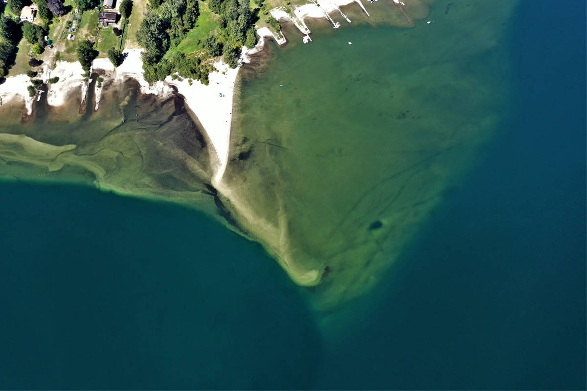 Six Mile Beach outside Nelson is known for its perfect sand, clear water and unique sand spit. But the drowning death of a man in July has residents asking if the dangerous spot has become too popular. Photo: David Grantham/Kootenay Drone Services