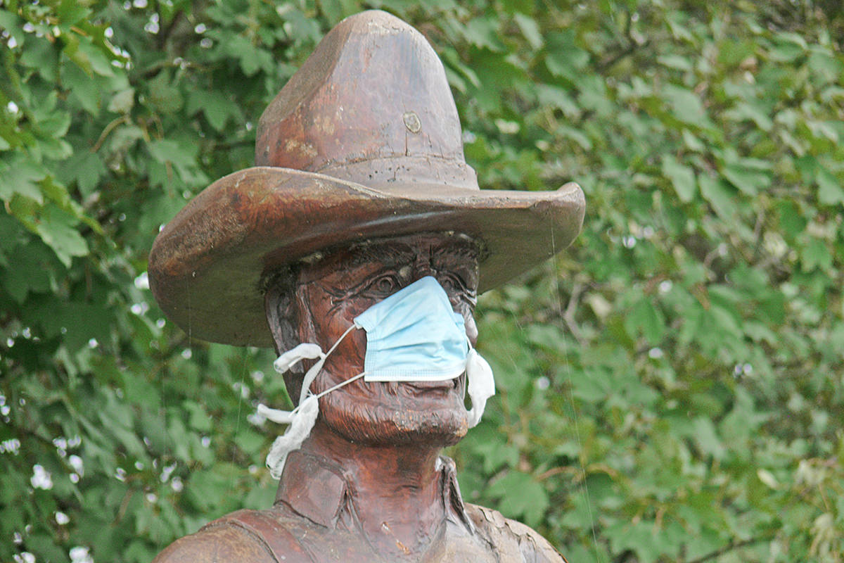Seen on Saturday, Oct. 17, 2020, a mask has been placed on this Langley statue that pays tribute to farmers from the early days (Dan Ferguson/Langley Advance Times)