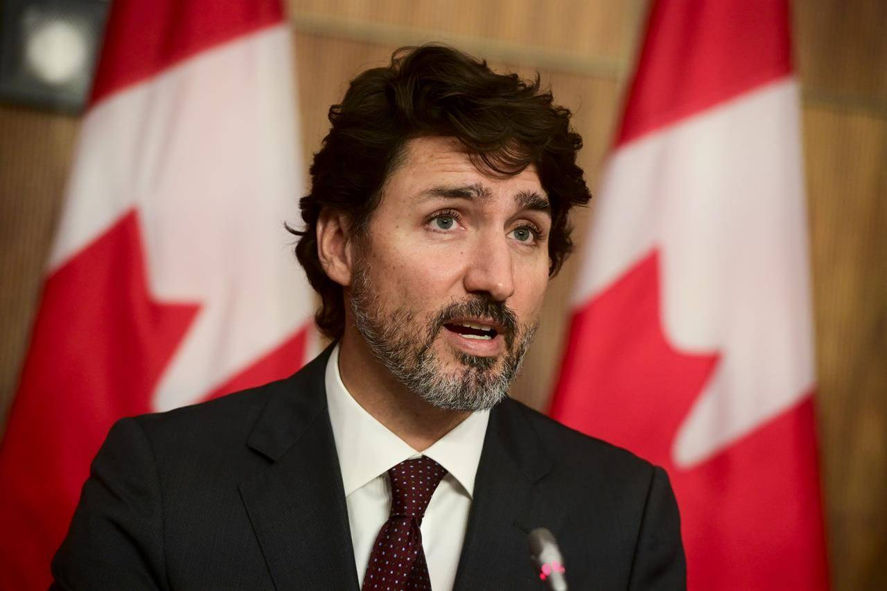 Prime Minister Justin Trudeau takes part in a press conference during the COVID pandemic in Ottawa, Tuesday, Oct. 13, 2020. Prime Minister Justin Trudeau says provinces have to do more work to address racism in the health-care system. THE CANADIAN PRESS/Sean Kilpatrick