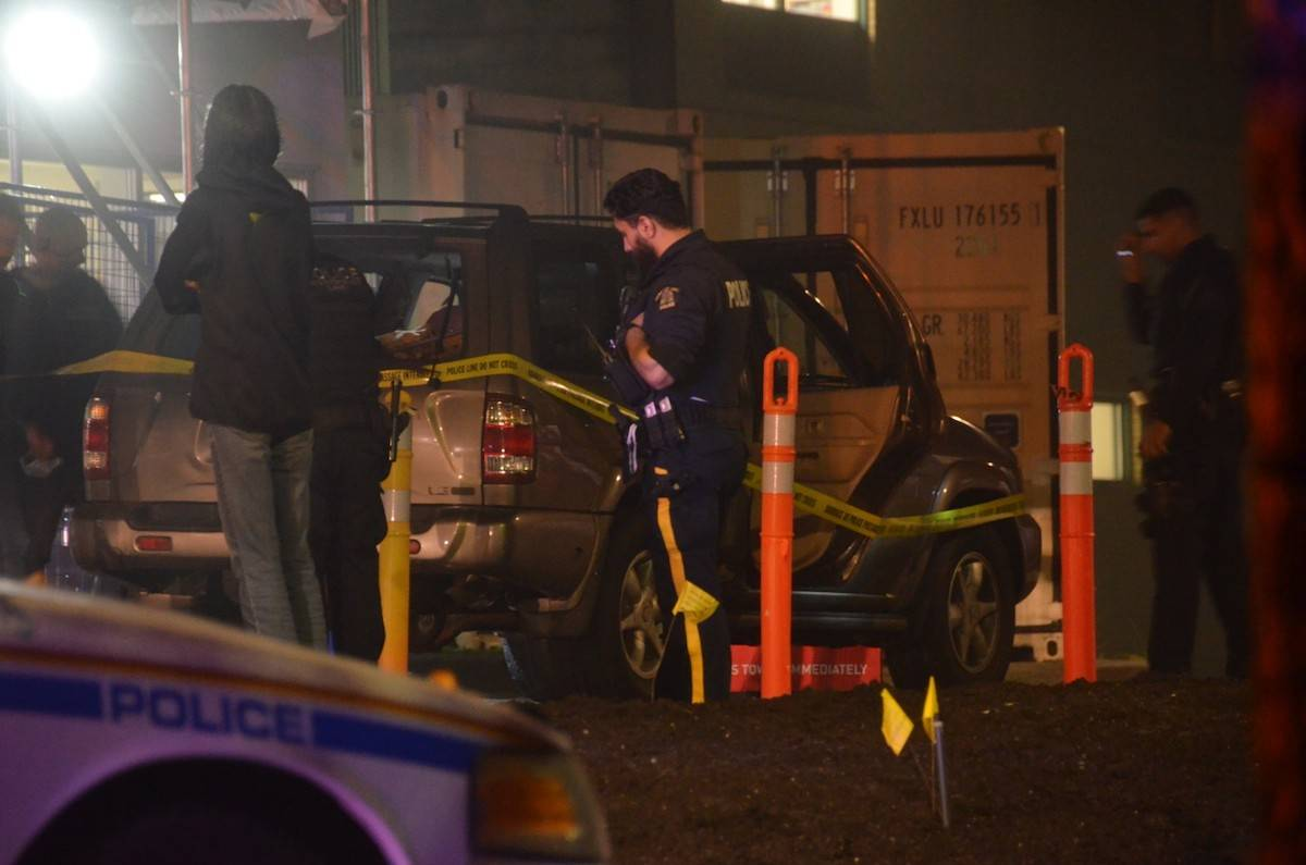 Police surround a vehicle with smashed windows outside Langley Memorial Hospital on Sunday evening (Oct. 18) at around 9 p.m., in possible connection to a shooting in Surrey at the intersection of 184th Street and 80th Avenue earlier that evening. (Photo: Curtis Kreklau/South Fraser News Services)