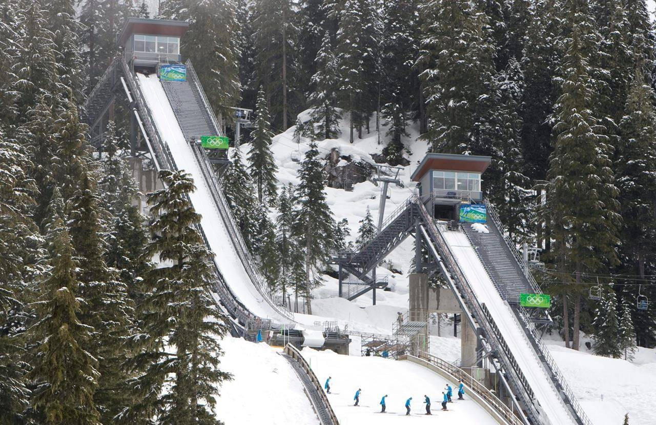 Course workers prepare the landing area at the ski jump venue in Whistler Olympic Park in Whistler, B.C. Friday, Feb. 5, 2010. THE CANADIAN PRESS/Jonathan Hayward