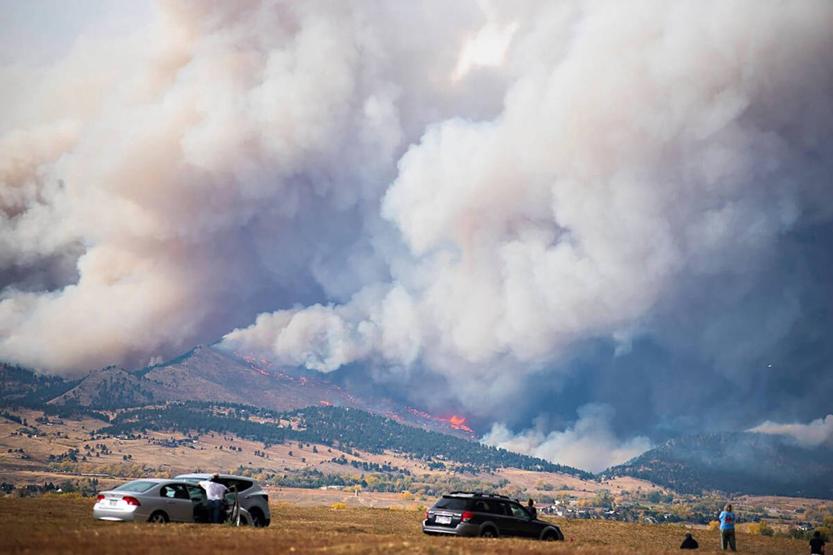 In this photo provided by Shannon Kiss, smoke from the CalWood Fire billows, Sunday, Oct. 18, 2020, as seen from Gunbarrel, Colo. (Shannon Kiss via AP)