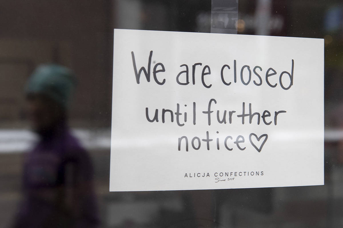 FILE – A sign on a shop window indicates the store is closed in Ottawa, Monday March 23, 2020. Companies that have laid off workers are telling the Bank of Canada they plan to refill some positions over the next year, but many hiring plans remain muted over COVID-19-related uncertainty. THE CANADIAN PRESS/Adrian Wyld