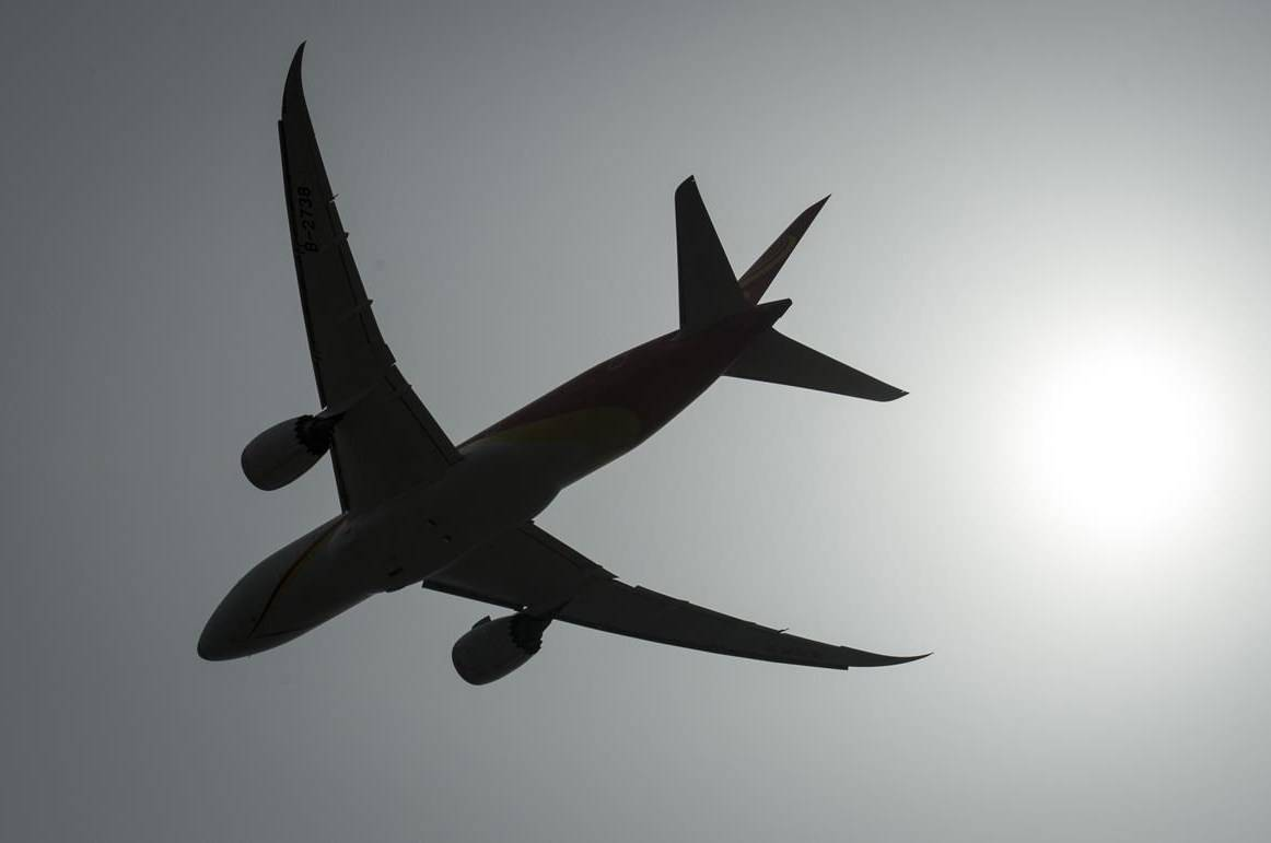 A plane is silhouetted as it takes off from Vancouver International Airport in Richmond, B.C., Monday, May 13, 2019. Regional airlines are demanding immediate action from Ottawa to prop up the beleaguered sector, but reject the idea of a federal stake in carriers. THE CANADIAN PRESS/Jonathan Hayward