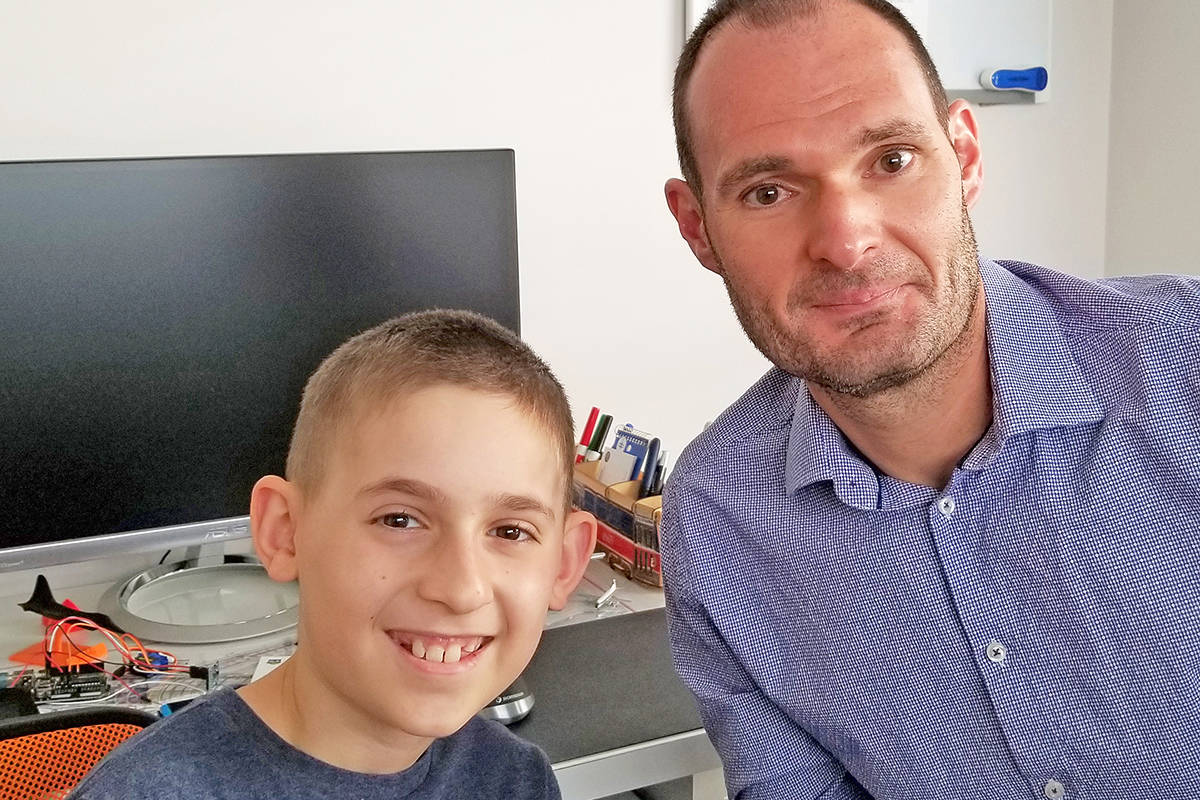 Bernard Trest and his son Max, 10, are concerned about B.C.'s plan for students in the classroom. He was one of two fathers who filed a court application in August to prevent schools from reopening if stricter COVID-19 protections weren't in place. That application was dismissed last week. (Contributed photo)