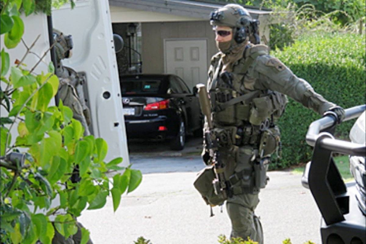 Officers with the Lower Mainland Emergency Response Team were at a White Rock home Tuesday (Oct. 20) to assist Vancouver Police Department with execution of a search warrant. (Contributed photo)