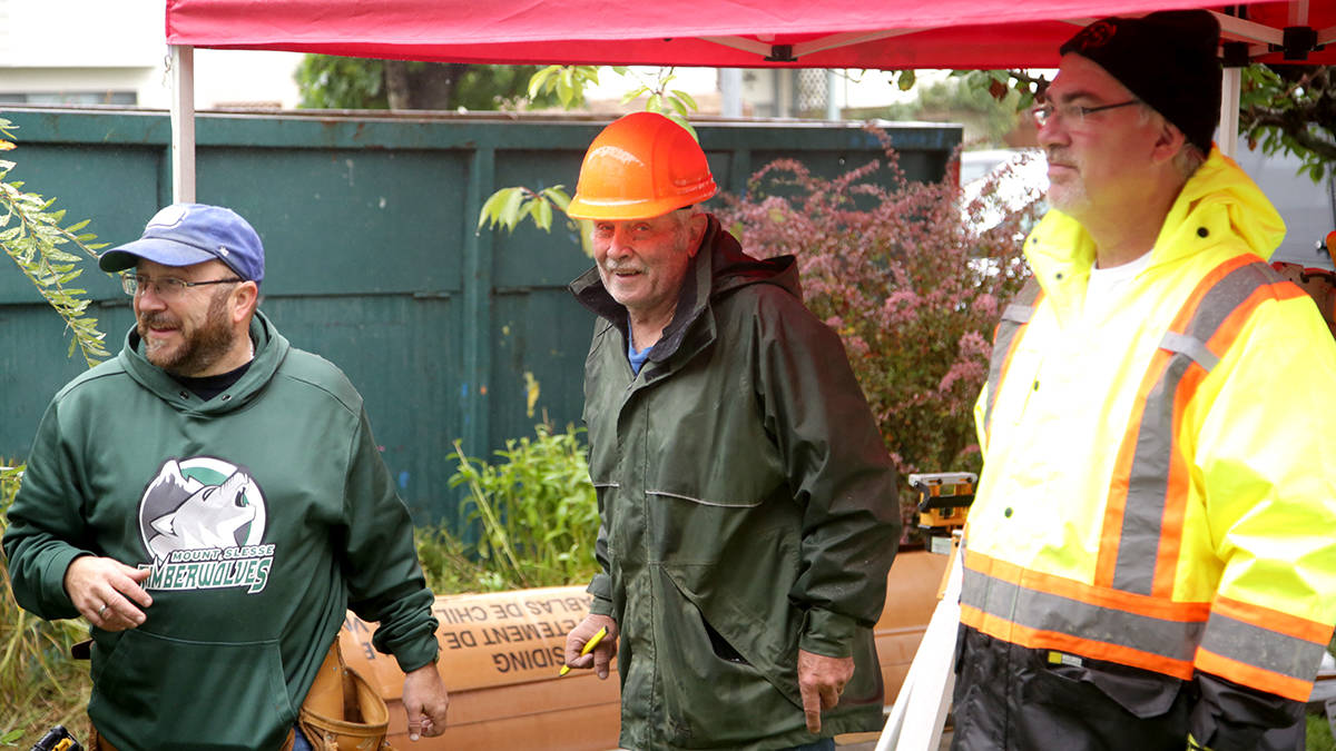 Volunteers helped install new windows as part of Acts of Kindness' mini home makeover. (Anderline Bredy/Special to the Aldergrove Star)