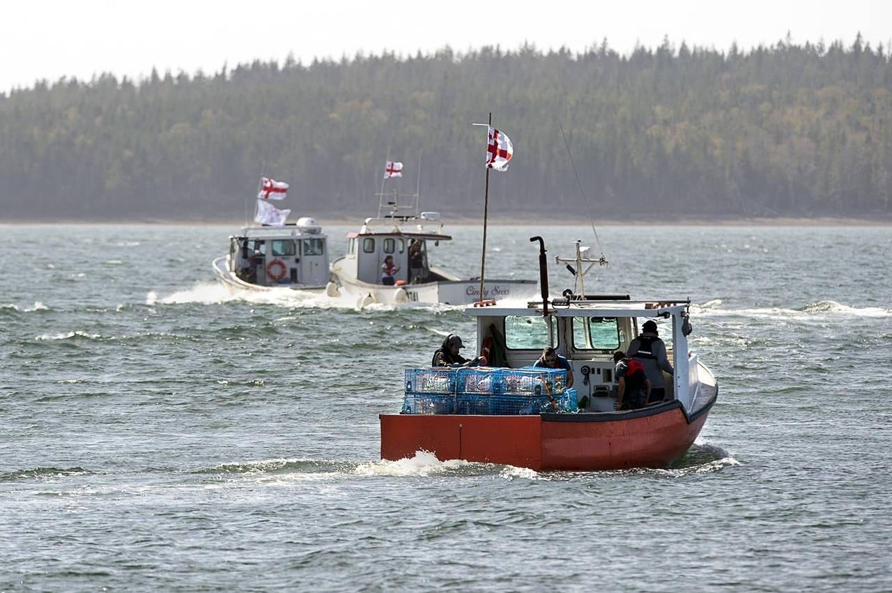 Members of the Potlotek First Nation, head out into St. Peters Bay from the wharf in St. Peter's, N.S. as they participate in a self-regulated commercial lobster fishery on Thursday, Oct. 1, 2020. THE CANADIAN PRESS /Andrew Vaughan