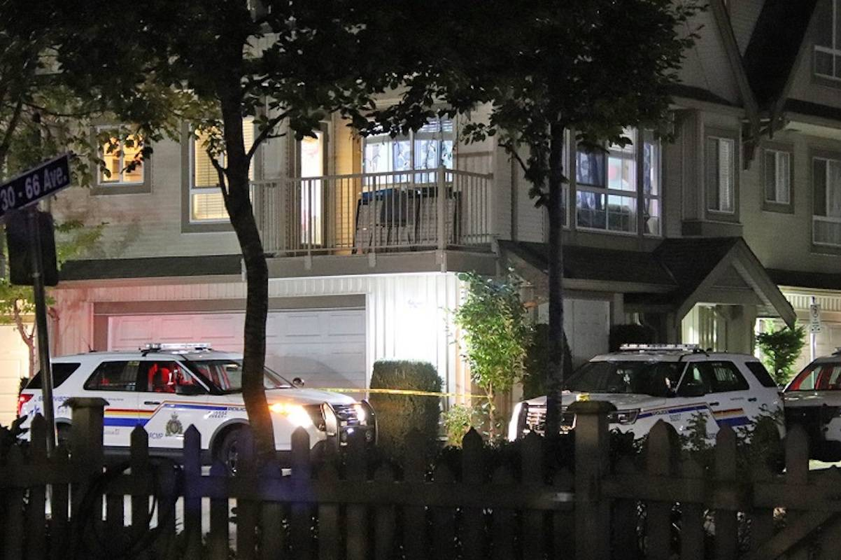 Surrey RCMP cruisers outside a Newton townhouse Tuesday night. (Photo: Shane MacKichan)