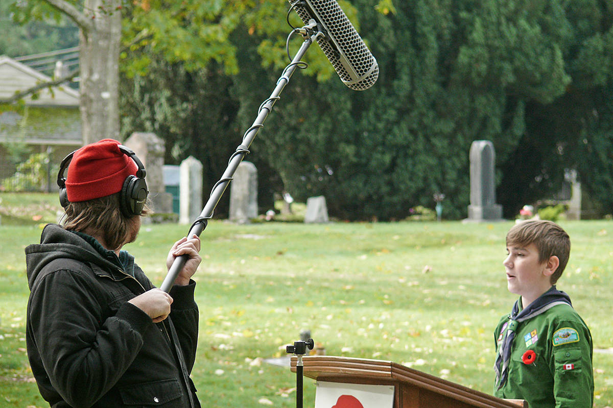 A scout pre-recorded his portion of the Remembrance Day service at the Fort Langley Cenotaph on Saturday, Oct. 25, 2020. Because of COVID-19, organizers have moved the event online this year. (Dan Ferguson/Langley Advance Times)