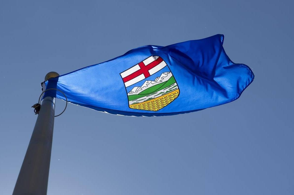 "Alberta's provincial flag flies on a flag pole in Ottawa, Monday, July 6, 2020. Advisers are reportedly recommending Alberta's kindergarten to Grade 4 arts and social studies curriculum remove all references to residential schools because it's ""too sad"" for young children. THE CANADIAN PRESS/Adrian Wyld"