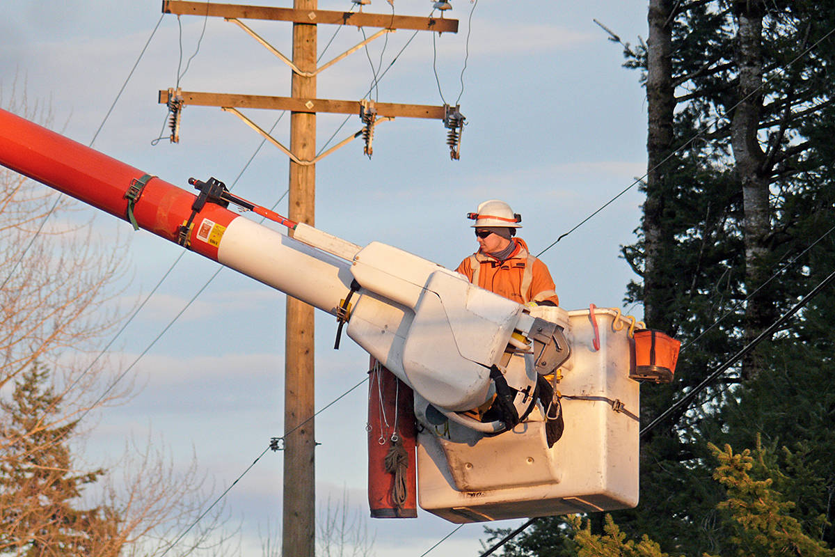 A worker restored a downed power line in Langley Township. (Dan Ferguson/Langley Advance Times)