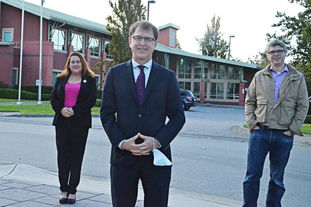 Adrian Dix was flanked by Langley East NDP candidate Megan Dykeman (left) and Langley NDP candidate Andrew Mercier (right) during a Thursday morning campaign stop near Langley Memorial Hospital. (Matthew Claxton/Langley Advance Times)